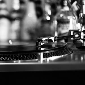 A picture of a turntable and bottles